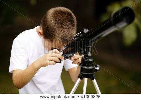 little boy with telescope