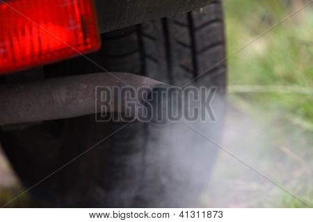 Motor car exhaust pipe emissions