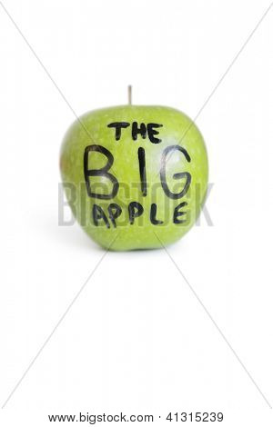 Close-up of text on a green apple over white background