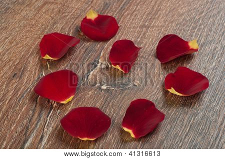 Roses Petals On Wooden Board
