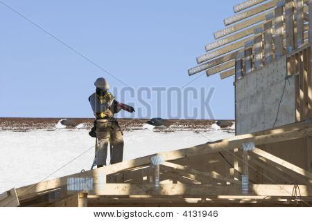 Roofer Loading His Nailgun