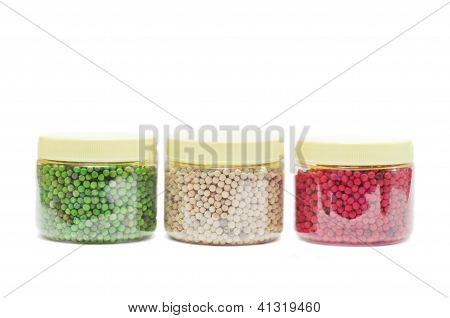 Red, Green And White Peppercorns Isolated On White Background