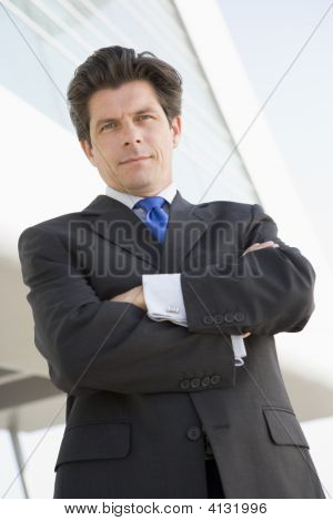 Businessman Standing Outdoors By Building