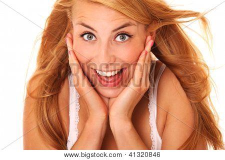 Ein Bild von einer jungen überrascht Frau lächelnd over white background