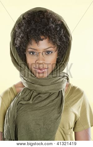 Portrait of a smart African American woman wearing glasses with stole over her head
