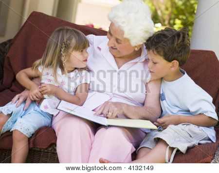 Grandmother Reading To Grandchildren.