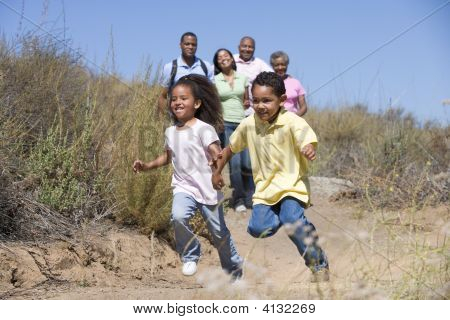 Extended Families Walking In Countryside