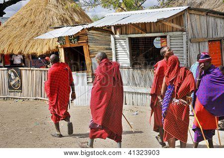 Masai walking through the Arusha village