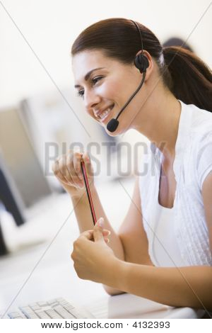 Woman Wearing Headset In Computer Room Smiling