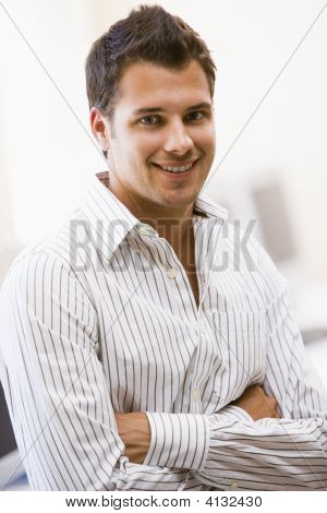 Man Standing In Computer Room Smiling