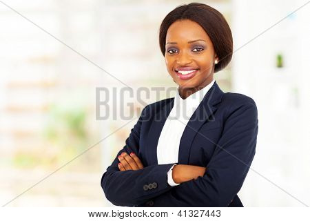 pretty african american businesswoman half length portrait in office