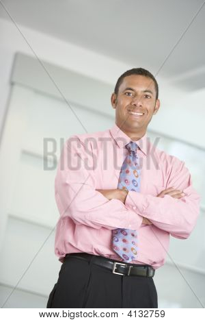 Businessman Standing Indoors Smiling
