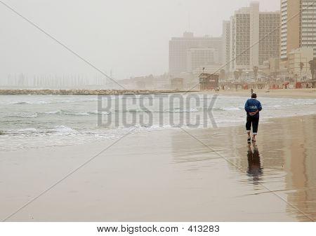 Walking On Winter Beach