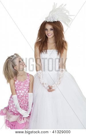 Beautiful young bride with bridesmaid over white background