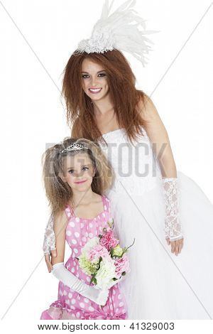Happy bride with bridesmaid holding bouquet over white background