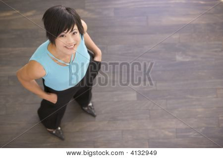Businesswoman Standing Indoors Smiling