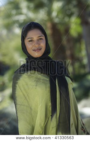 Portrait of an Indian woman wrapped with black and green dupatta