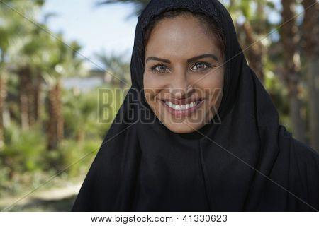 Portrait of an Indian woman in burkha smiling