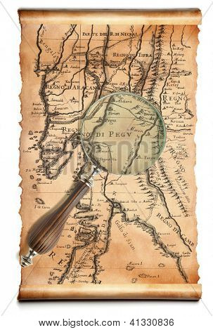 Magnifying glass  and ancient scroll map isolated over a white background