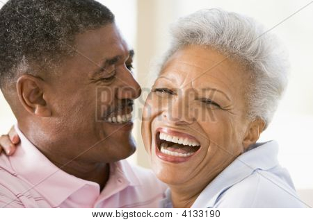 Couples Relaxing Indoors Laughing