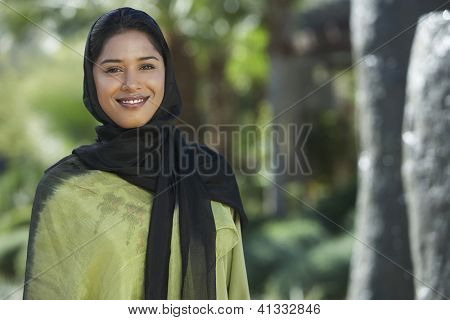 Portrait of a happy Indian woman wrapped with black and green dupatta
