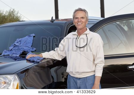 Middle age man standing next to his car