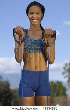 Portrait of a beautiful middle aged woman exercising