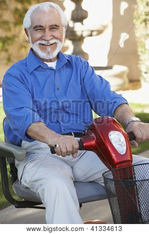 Portrait of a cheerful senior man on electric scooter