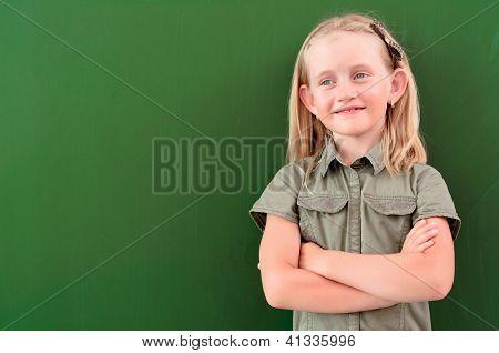 schoolgirl portrait near the blackboards
