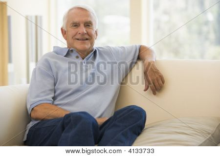Man In Living Room Smiling