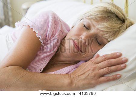 Woman Lying In Bed Sleeping