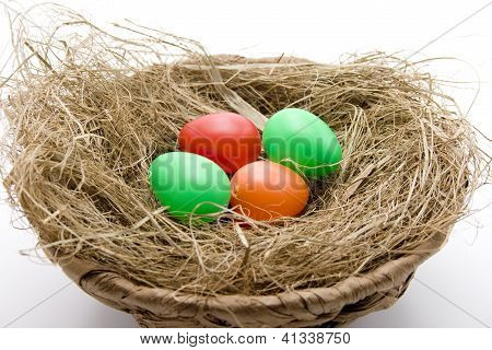 Different Eastereggs in Easterbasket on white background