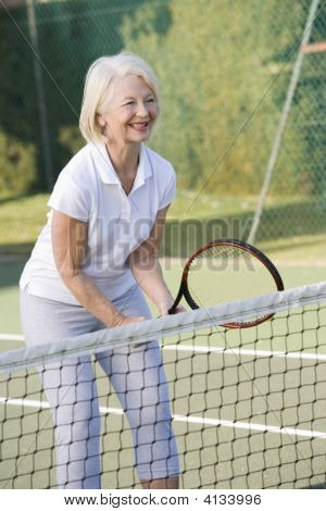 Woman Playing Tennis And Smiling