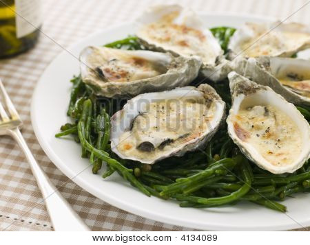 Grilled Oysters With Mornay Sauce On Samphire