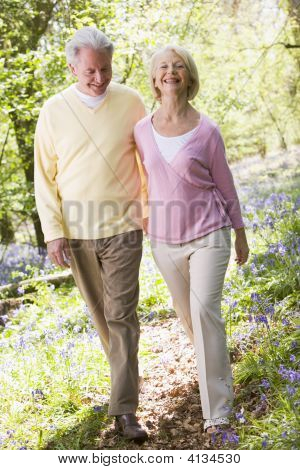 Couples Walking Outdoors Smiling