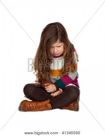 Sad little girl with long hair sitting over a white background