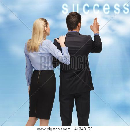 picture of man and woman with success word button in the sky