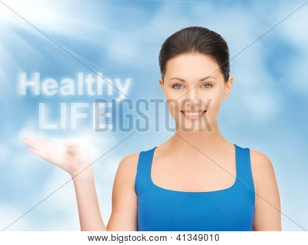 picture of woman holding healthy life words on the palm