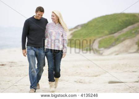 Couples Walking At Beach Smiling