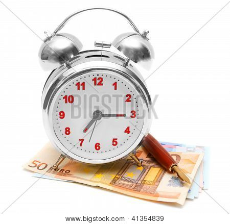 Alarm clock, pen and a pack of money. On a white background.