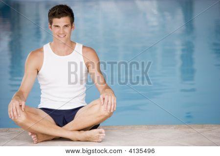 Man Sitting Poolside Smiling