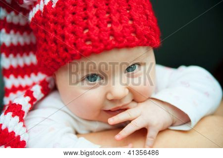 child of tender years in red hat