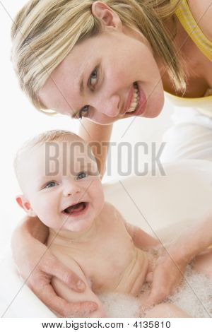 Mother Giving Baby Bubble Bath Smiling