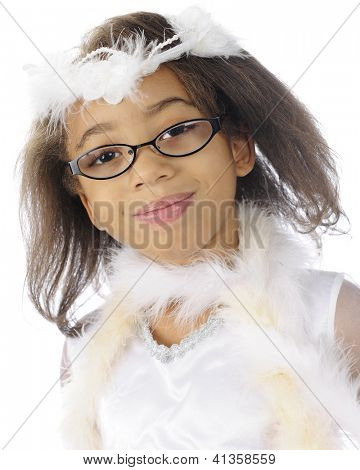 Head and shoulders portrait of a pretty African American elementary girl dressed up in a white dress, boats and a fluffy halo-hairpiece.  On a white background.