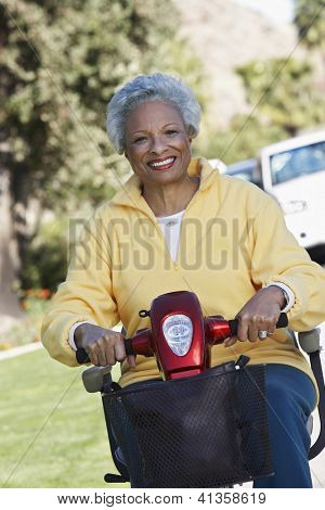 Portrait of an African American woman on electric scooter
