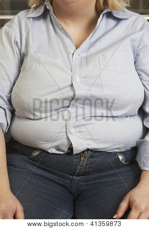 Midsection of an obese woman in casual wear