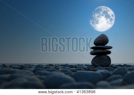 Stacked Stones In Moonlight