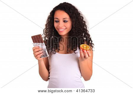 Young Woman Holding Orange And Chocolate. Isolated Over White. Isolated Over White