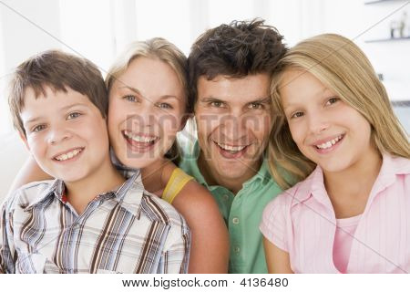 Families In Living Room Smiling