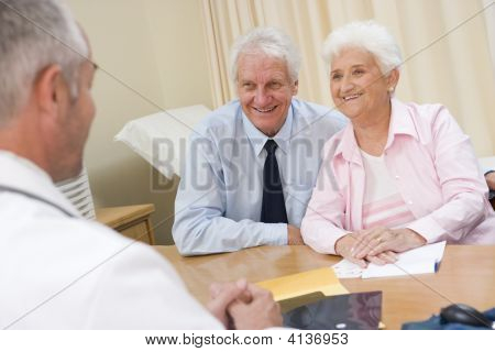 Couples In Doctor'S Office Smiling
